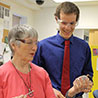 PHOTO: Joe Bannister confers with Dr. Louise Temple in the biotechnology lab